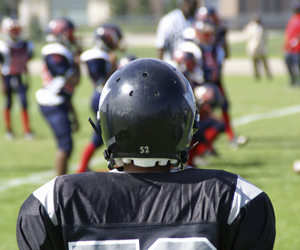 football kid on the sidelines
